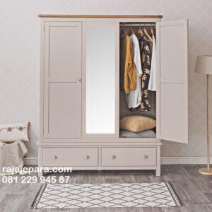 Lemari pakaian minimalis modern 3 pintu kaca cermin warna putih cat duco model desain almari baju terbaru dari kayu mahoni Jepara harga murah
